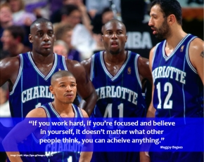 Muggsy Bogues standing alongside his team mates.
